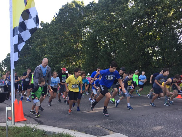Runners Raise Funds And Remember Fallen Officer At Memorial 5.5K