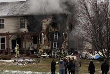 Three killed after light plane crashes into Detroit home